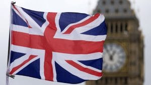 A Union flag flies in the wind in front of the Big Ben clock face and the Elizabeth Tower at the Houses of Parliament in central London on June 22, 2016, ahead of the June 23 EU referendum. Rival sides threw their efforts into the final day of campaigning Wednesday, on the eve of Britain's vote on EU membership that will shape the future of Europe. / AFP / JUSTIN TALLIS